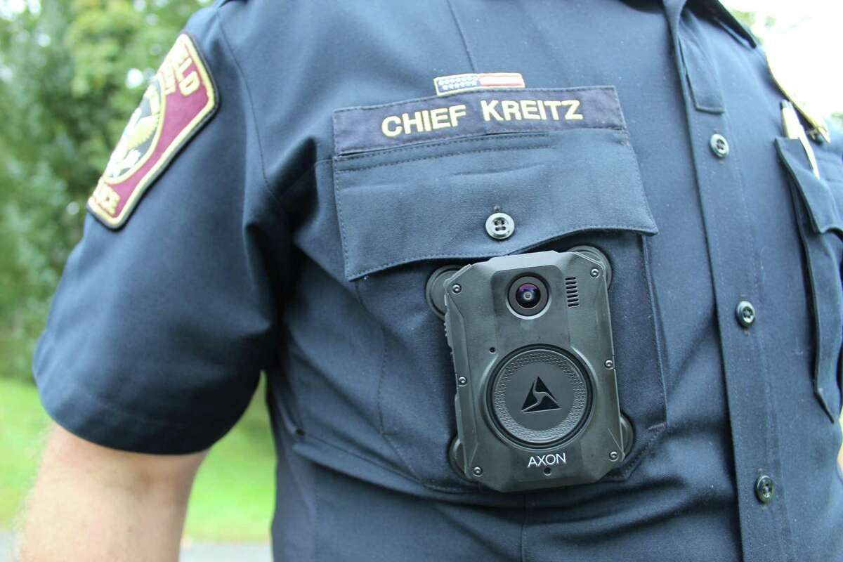 Ridgefield Police Chief Jeff Kreitz displays his Axon body camera. The body cams are connected to an officer's taser and firearm via Bluetooth to ensure that when either is discharged the camera will automatically turn on.