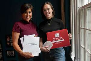 Dr. Corey Jamison and her business partner Julie Bush hold the contents of their DIY Marriage Retreat in a Box in Corey's home on Friday, Sept. 17, 2021 in Troy, N.Y.  The two have created a DIY marriage retreat box to help couples who might be struggling to connect.