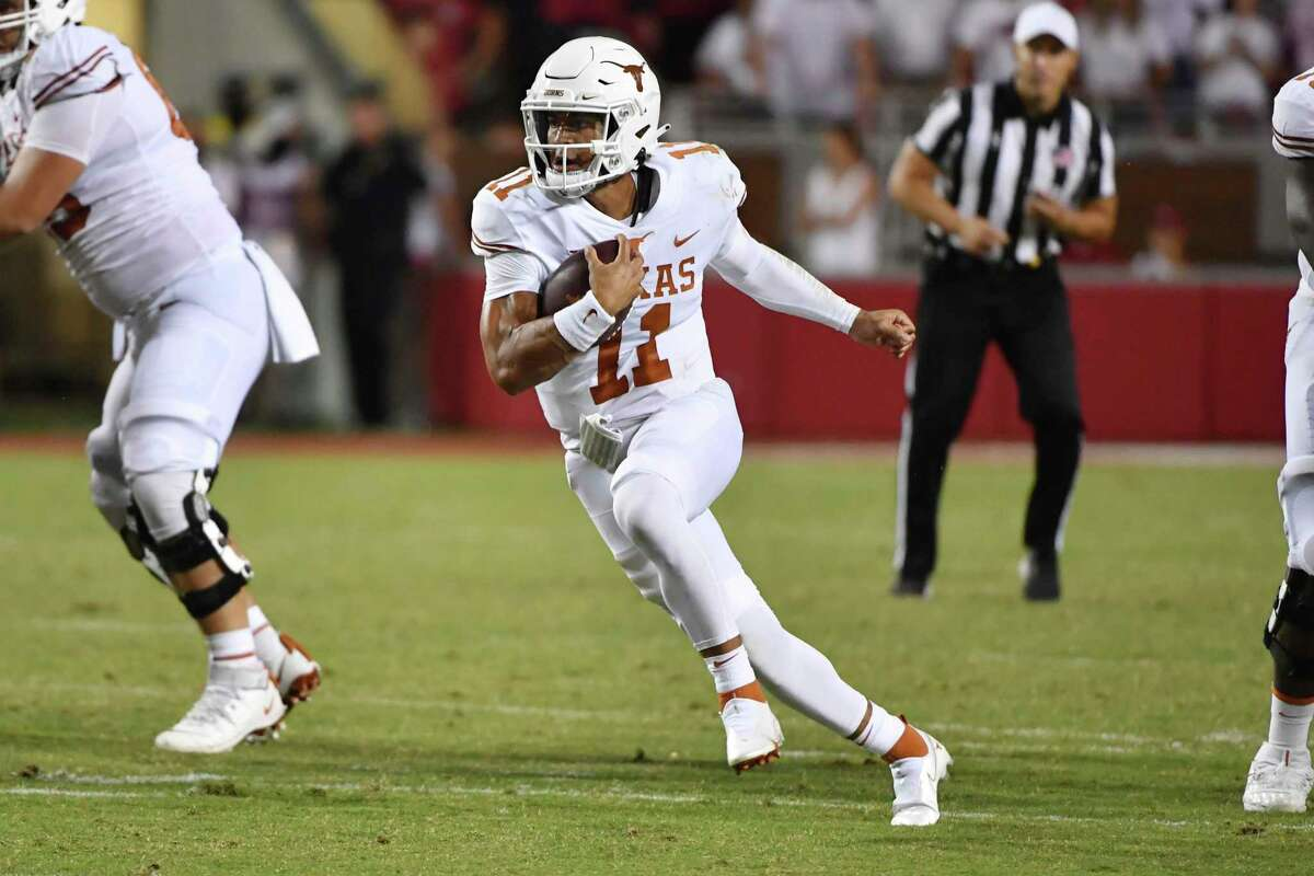 Texas quarterback Casey Thompson (11) runs the ball against Arkansas during an NCAA college football game Saturday, Sept. 11, 2021, in Fayetteville, Ark. (AP Photo/Michael Woods)