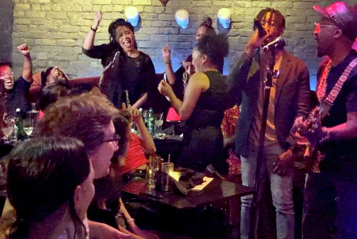 San Francisco Mayor London Breed (standing left) watches Raphael Saadiq and D'Wayne Wiggins of Tony! Toni! Toné! perform at the Black Cat in San Francisco on Wednesday.