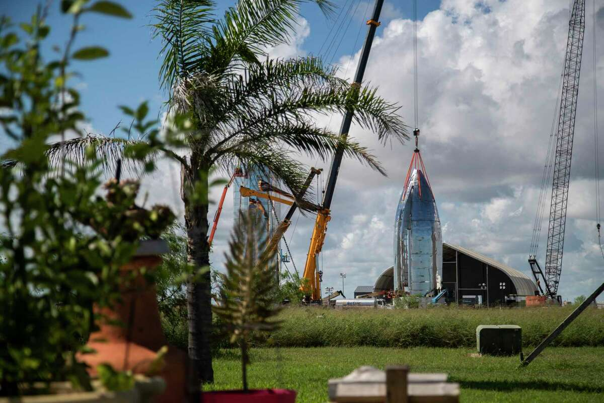 View of SpaceX's Starship vehicle from the front yard of Maria Pointer on Friday, Sept. 27, 2019, in Boca Chica. The SpaceX's prototype resembling an old sci-fi movie rocket of the 50s, will be fully reusable transportation system designed to service all Earth orbit needs as well as the Moon and Mars.
