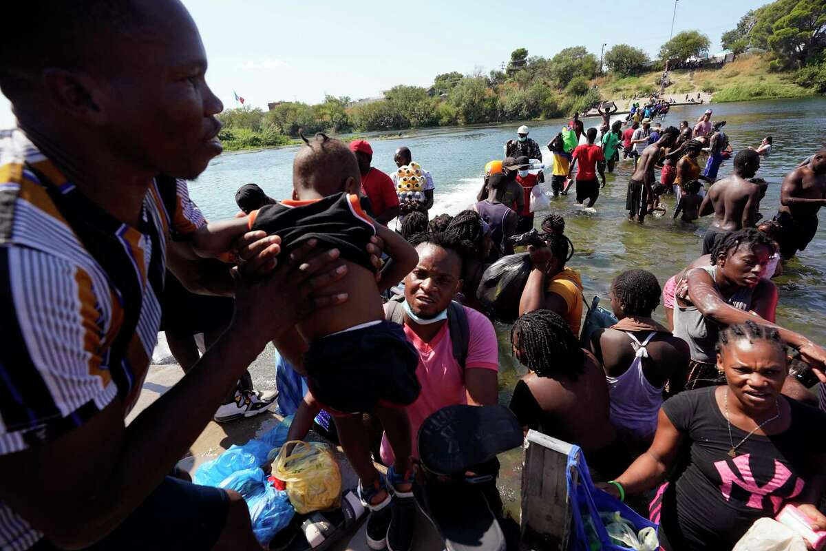 Haitian migrants use a dam to cross from Mexico into the United States in Del Rio, Texas. Thousands of Haitians have assembled under and around a bridge in Del Rio, presenting the Biden administration with a fresh challenge as it tries to manage large numbers of asylum-seekers.