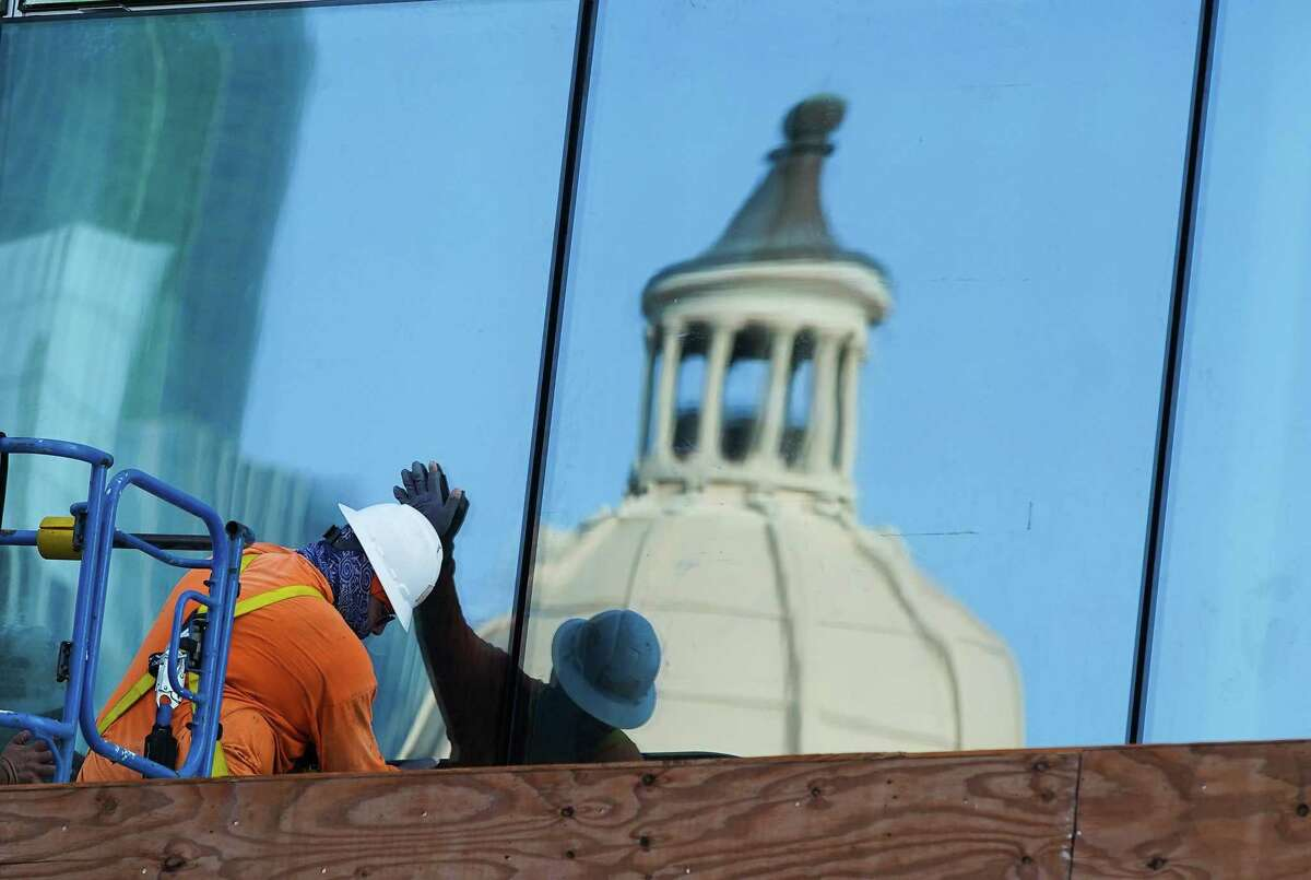 Construction crews put up windows on Harris County Courthouse in Houston on Thursday, Sept. 2, 2021.