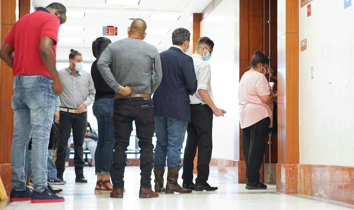 People line up to make their way into a courtroom at the Harris County Courthouse this month.