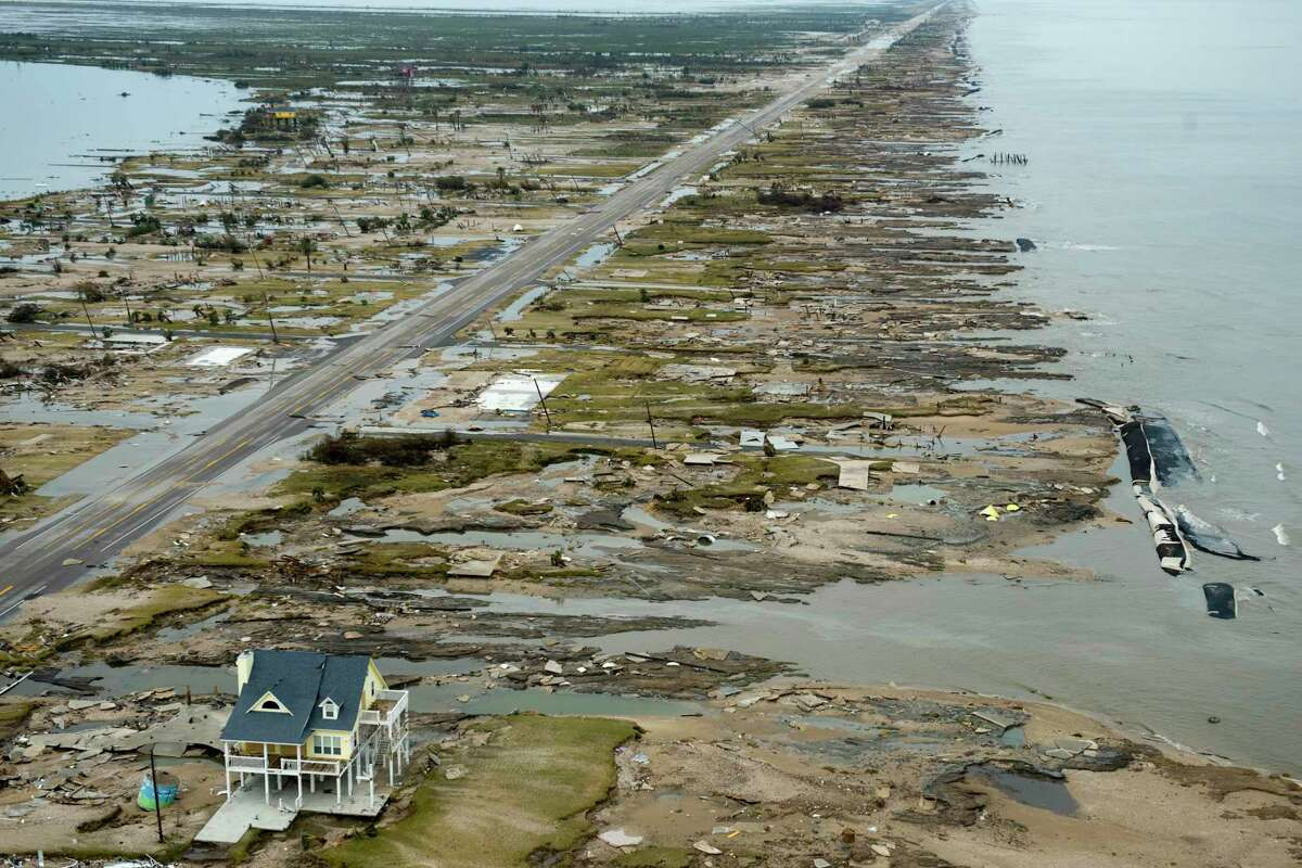 A single house is left standing amidst the devastation left by Hurricane Ike, Sunday, Sept. 14, 2008, in Gilchrist, Texas.