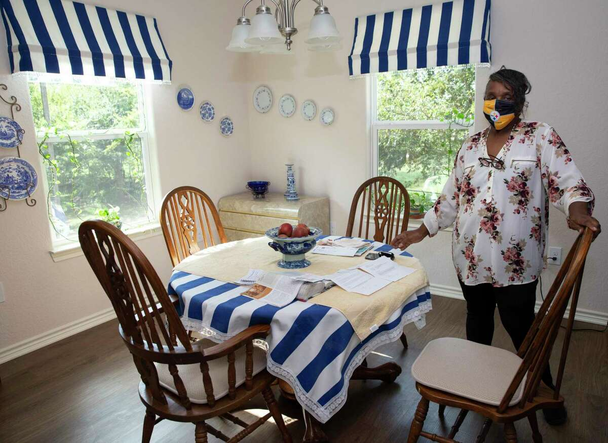Doris Jones, 77, shows the kitchen area of her new home Thursday, Sept. 16, 2021, in Simonton. Her old home flooded in 2016 and again during Harvey in 2017. After receiving assistance from the Texas GLO, they were able to rebuild after Hurricane Harvey. Jones, a veteran seamstress, made the drape and table cloth, and decorated the wall with her antique collection.