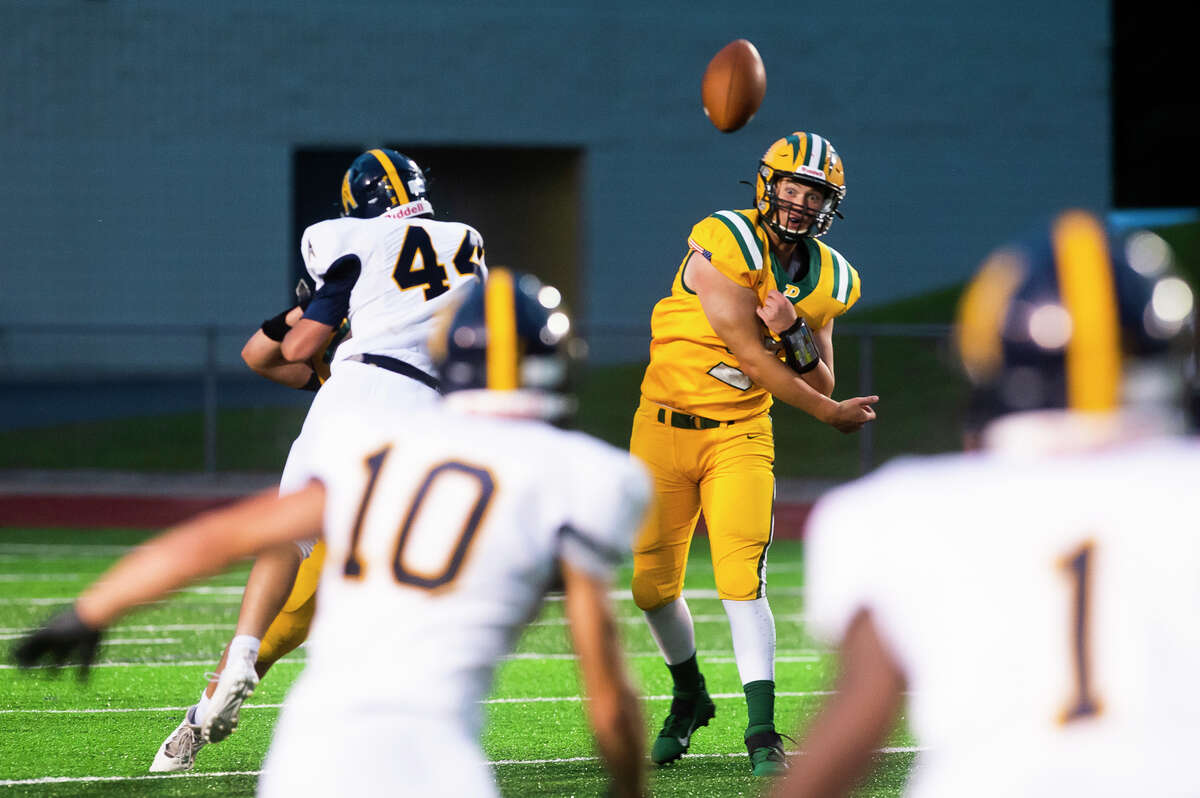 Dow's Jack Bakus attempts a pass to a teammate during the Chargers' game against Mt. Pleasant Friday, Sept. 17, 2021 at Midland Community Stadium. (Katy Kildee/kkildee@mdn.net)