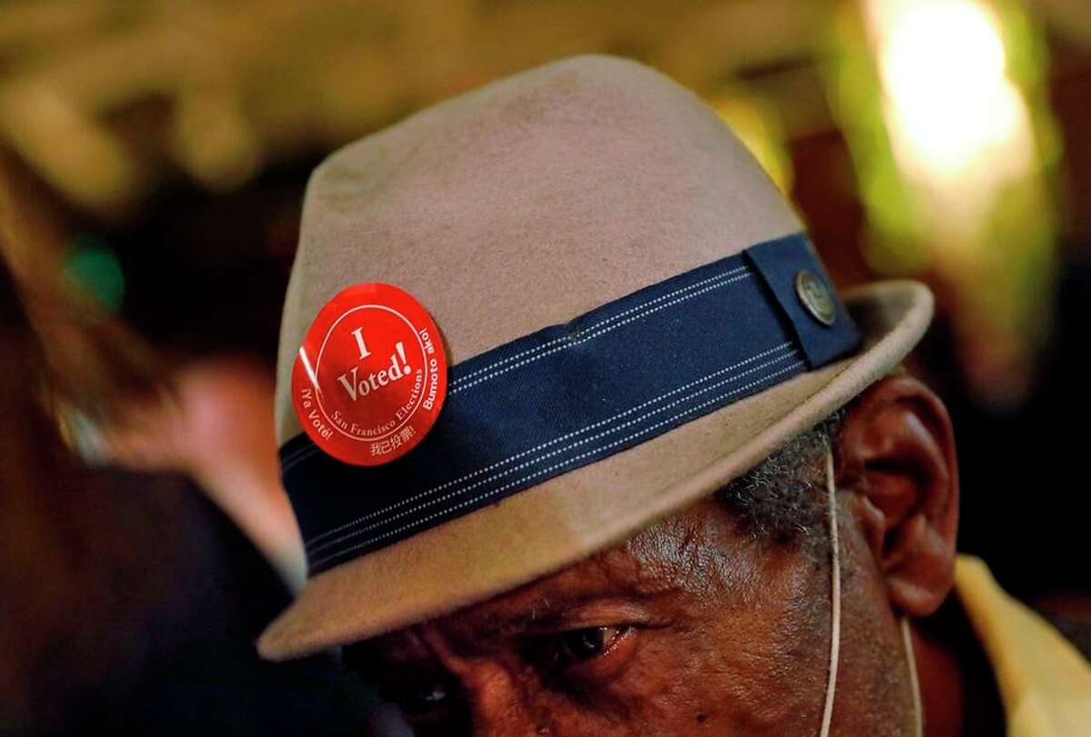 """Horace Thomas wears his, """"I Voted!"""" sticker on his hat as he and dozens of other supporters of Gov. Gavin Newsom gathered at Manny's in San Francisco on September 14 to watch the results in the California recall election."""