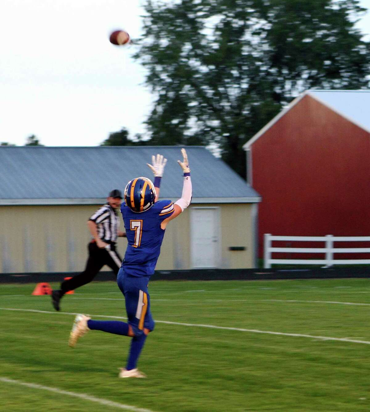 Evart junior wide receiver Jake Ladd chases down a long pass on his way to the end zone during the Wildcats' victory over Manton on Friday night at Tom Smith Memorial Stadium in Evart. (Pioneer photo/Joe Judd)