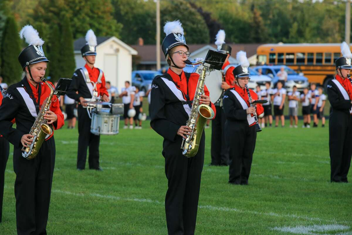 The band performs the national anthem before the Ubly and Harbor Beach football game in Ubly Friday night.
