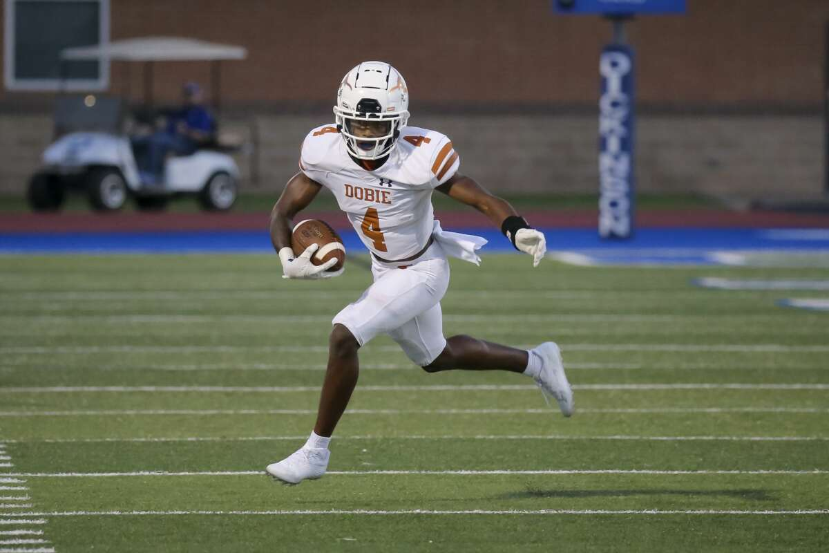 Dobie Longhorns running back Jalen Baldwin (4) carries the ball in the first quarter during the non-district high school football game between the Dobie Longhorns and Dickinson Gators on September 17, 2021 at Vitanza Stadium in Dickinson, TX.
