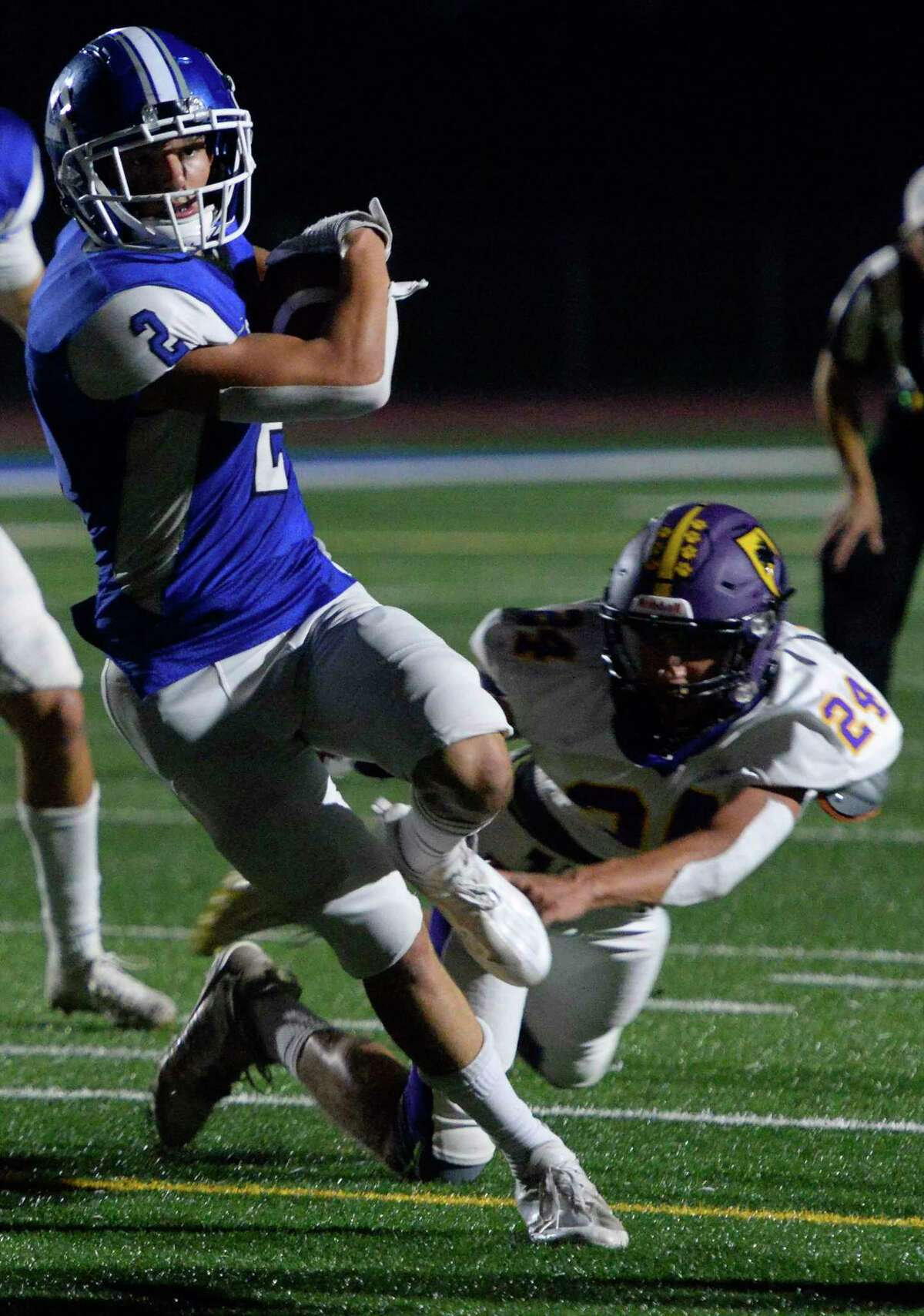 La Salle running back Dominick Nemier escapes a tackle against Ballston Spa. La Salle picked up a game against Burnt Hills after its original opponent, Albany, wasn't ready to start its season while waiting for vaccinations of its players to be completed.