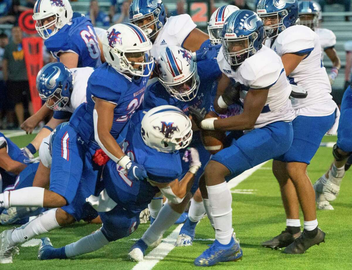 FW Nolan's Kewan Lacy has the ball stripped from his arms by Midland Christian players who recovered the fumble 09/17/2021 at Gordon Awtry Field. Tim Fischer/Reporter-Telegram