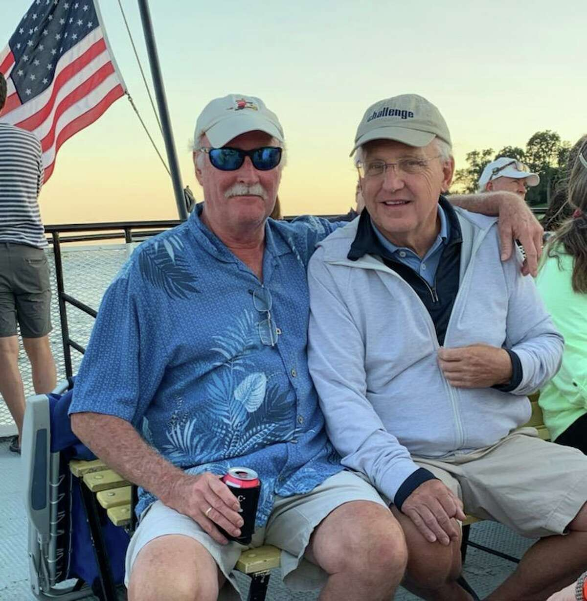 Greenwich native and resident Kevin O'Conner with Brian Curley as they take the last boat back after the traditional annual Curley Family Birthday Celebration at Island Beach last weekend.