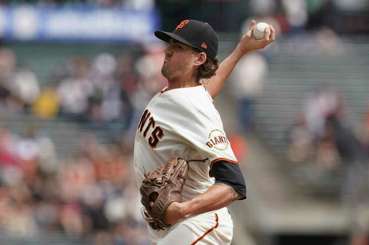San Francisco Giants' Kevin Gausman pitches against the San Diego Padres during the first inning of a baseball game in San Francisco, Thursday, Sept. 16, 2021. (AP Photo/Jeff Chiu)