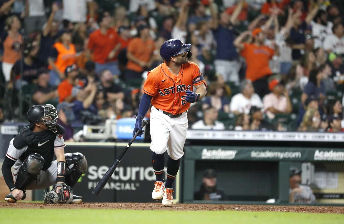 Houston Astros Jose Altuve (27) hits a two-run home run off of Arizona Diamondbacks starting pitcher Madison Bumgarner which was the first Astros hit of the night during the sixth inning of an MLB baseball game at Minute Maid Park, Friday, September 17, 2021, in Houston.