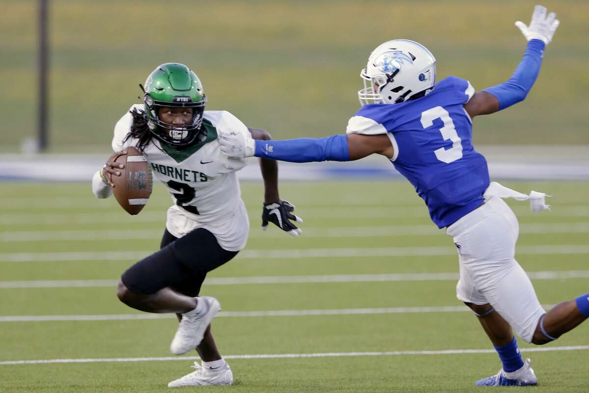 Huntsville wide receiver Justin Butcher (2) is caught by C.E. King defensive back Eric Adams (3) during the first half of a high school football game at Panther Stadium Friday, Sept. 17, 2021 in Houston, TX.