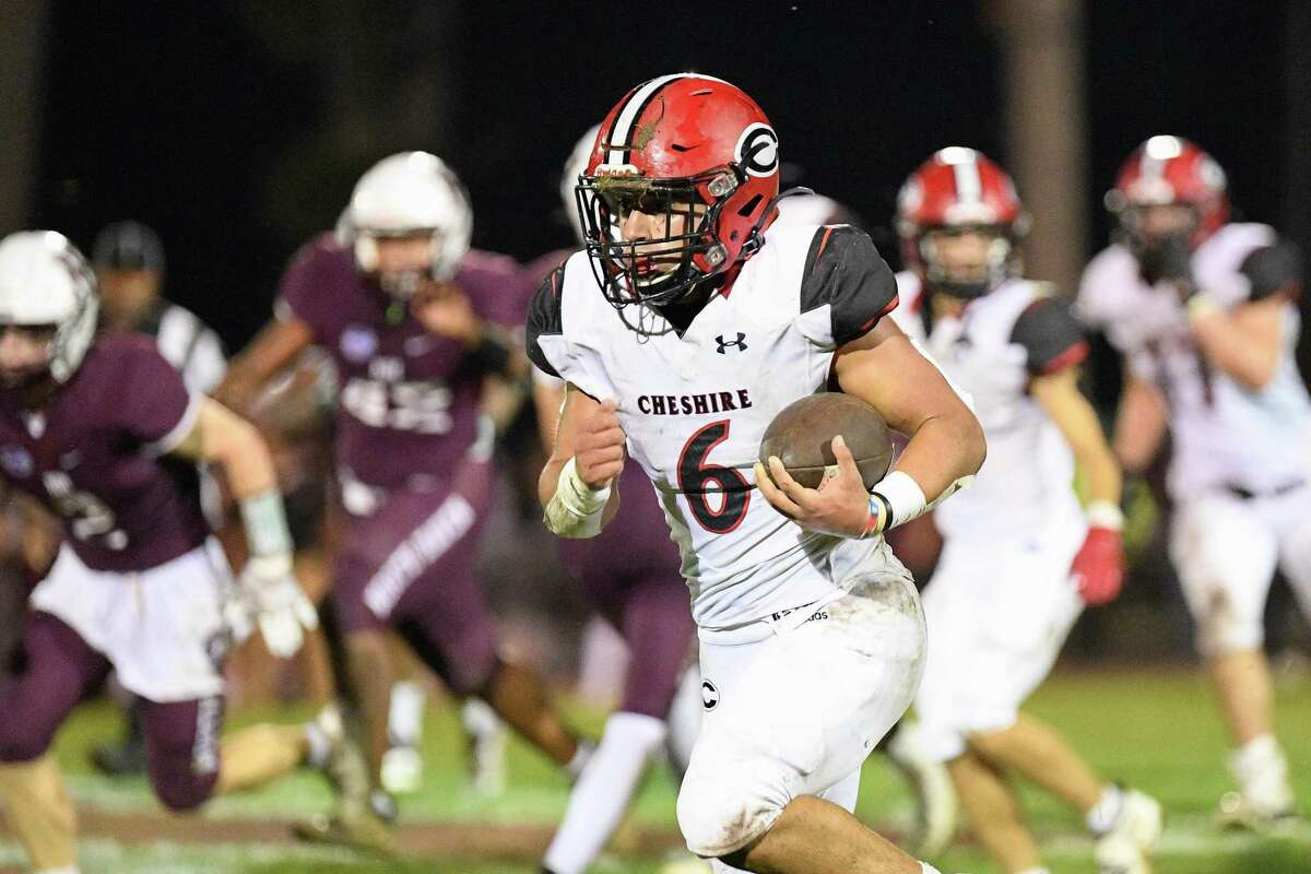 Cheshire High RB Christian Russo breaks a long run for his first touchdown of the night against North Haven Friday night at Vanacore Field in North Haven.