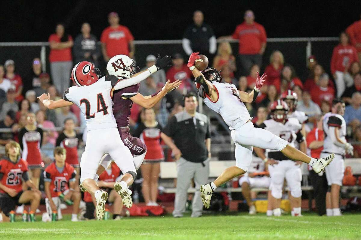 Cheshire High's E.J. Quint intercepts a first quarter pass against North Haven High Friday night.