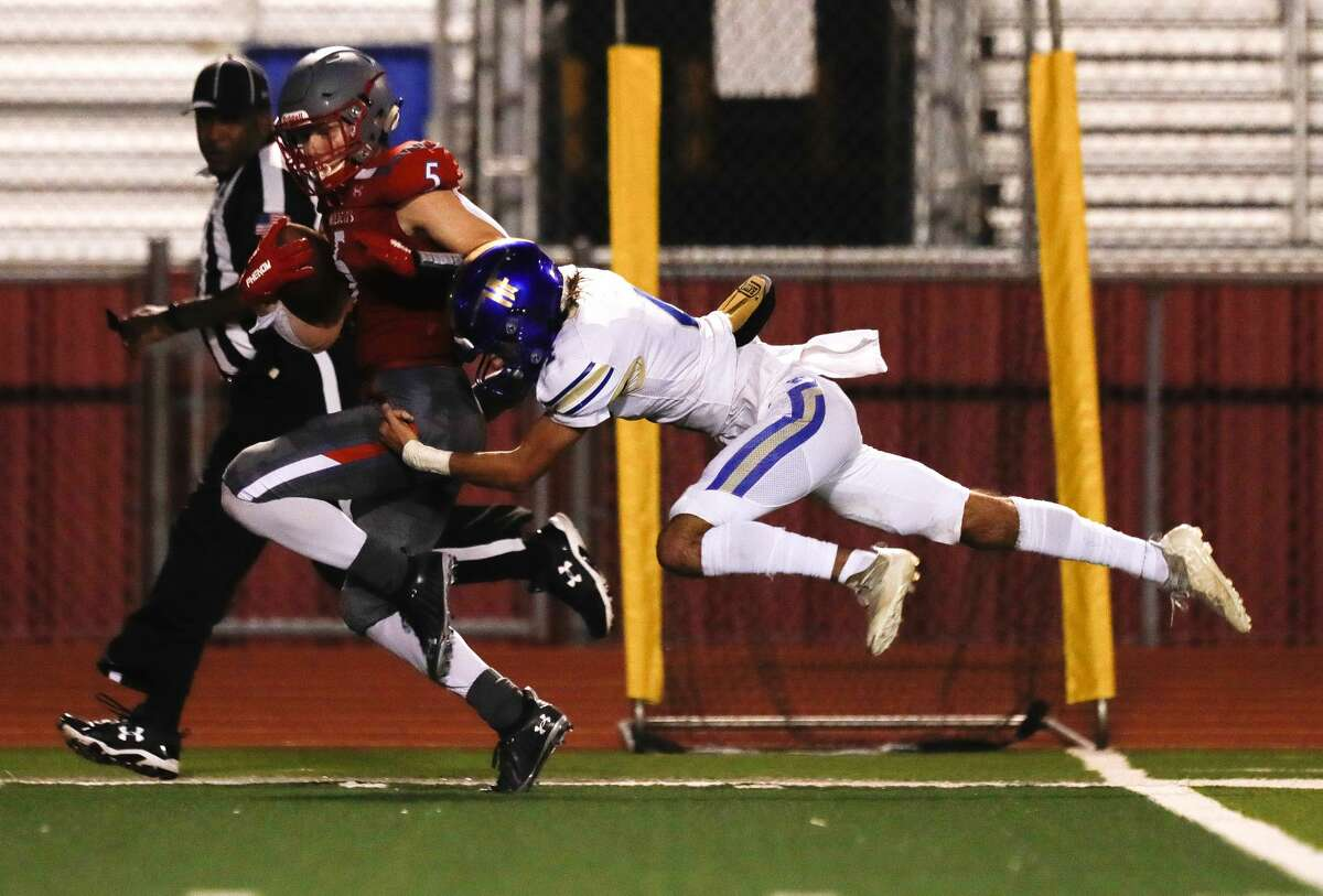 Splendora wide receiver Colby Fraizer (5) catches a 66-yard touchdown ahead of Hampshire-Fannett defensive back Tyler Spencer (10) during the second quarter of a high school football game, Friday, Sept. 16, 2021, in Splendora.