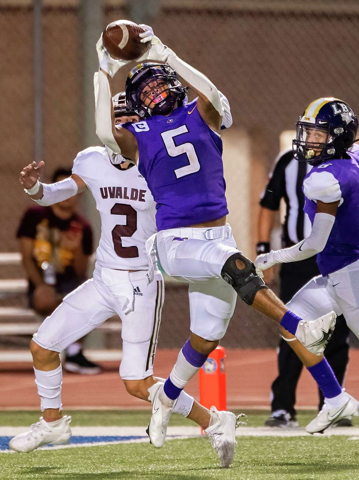 LBJ's Azael Rebollar gets an interception in the red zone against Uvalde on Friday, Sept. 17, 2021 at the SAC.