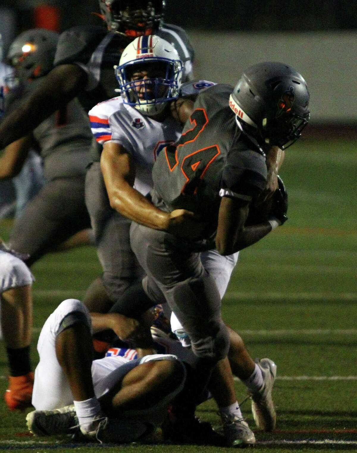 Danbury's Anthony Pellicone (8) tackles Stamford's Cam Jeane Pierre (24) during action on Friday.