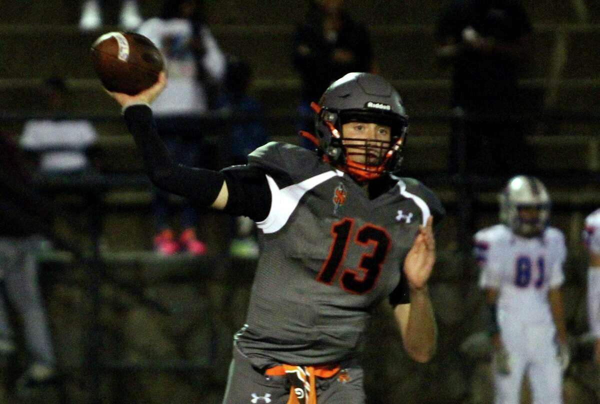 Stamford QB Jack Stokes throws a pass against Danbury in Stamford on Friday.