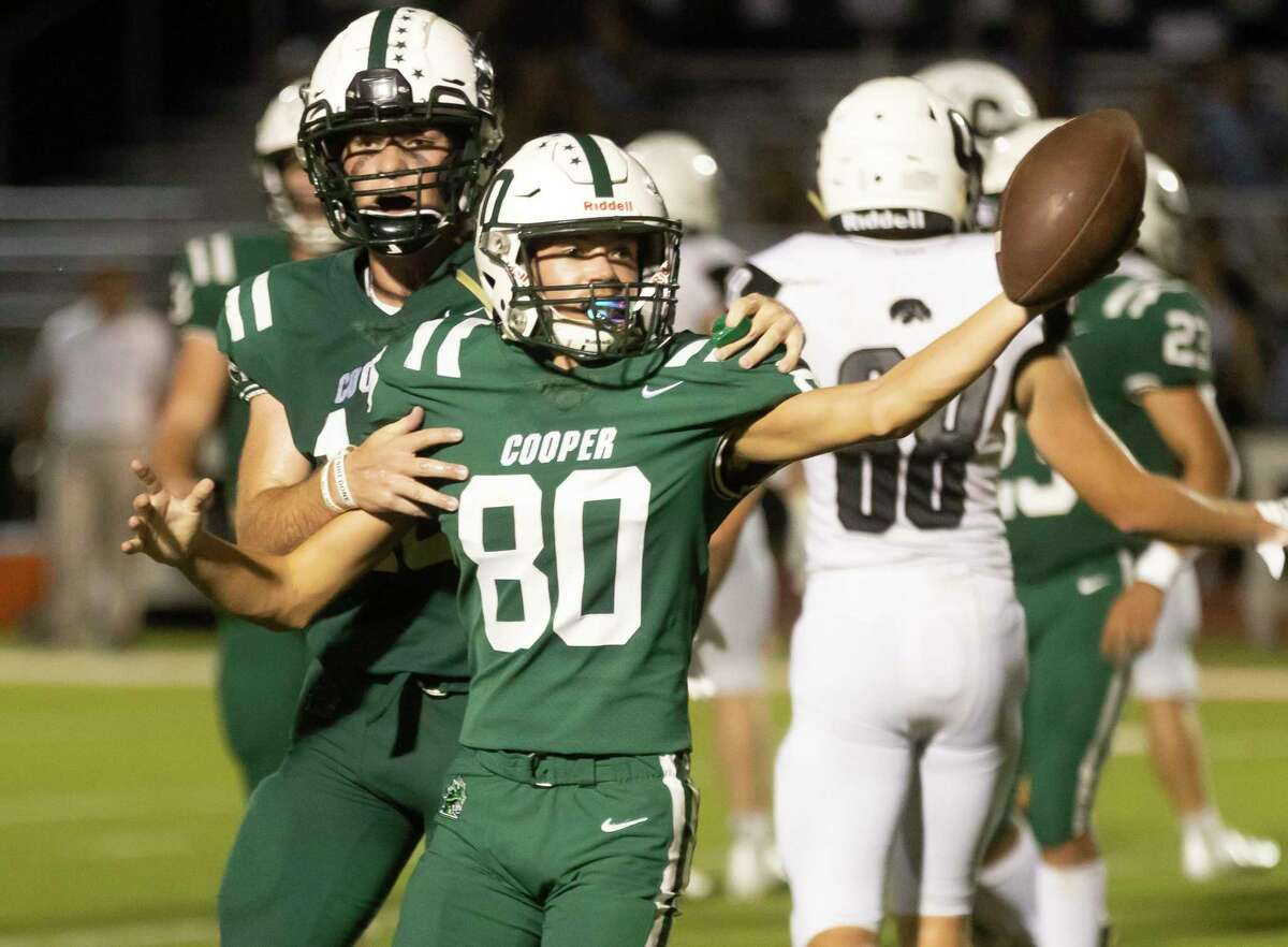 Jon Cooper Ronnie Woodall (80) celebrates after he intercepts a pass from Cistercian during the second quarter of a Southwest Prep 3A football game at The Woodlands Christian Academy, Friday, Sept. 17, 2021, in The Woodlands.