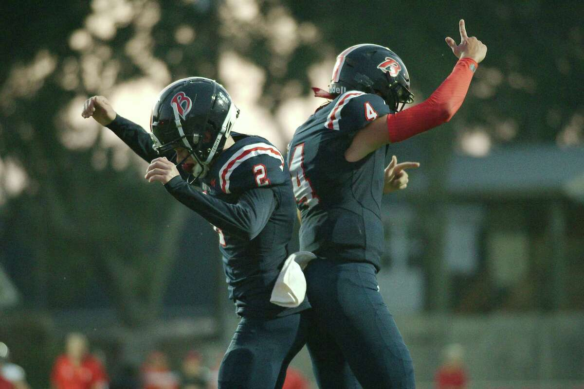 Bay Area Christian's Smith Nave (2) and Adam Atwell (4) celebrate a touchdown against Tomball Rosehill Christian Friday at Bay Area Christian High School.