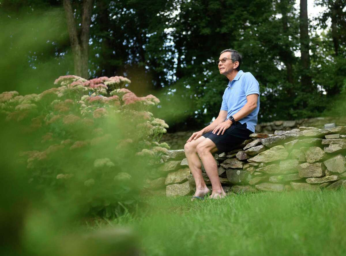 Robert Reiner, who identifies as Japanese American, poses outside his home in the backcountry of Greenwich, Conn. Tuesday, Aug. 31, 2021. Recently-released census shows major growth in Asian population in the Greenwich backcountry and midcountry, Riverside, North Mianus, and Old Greenwich.