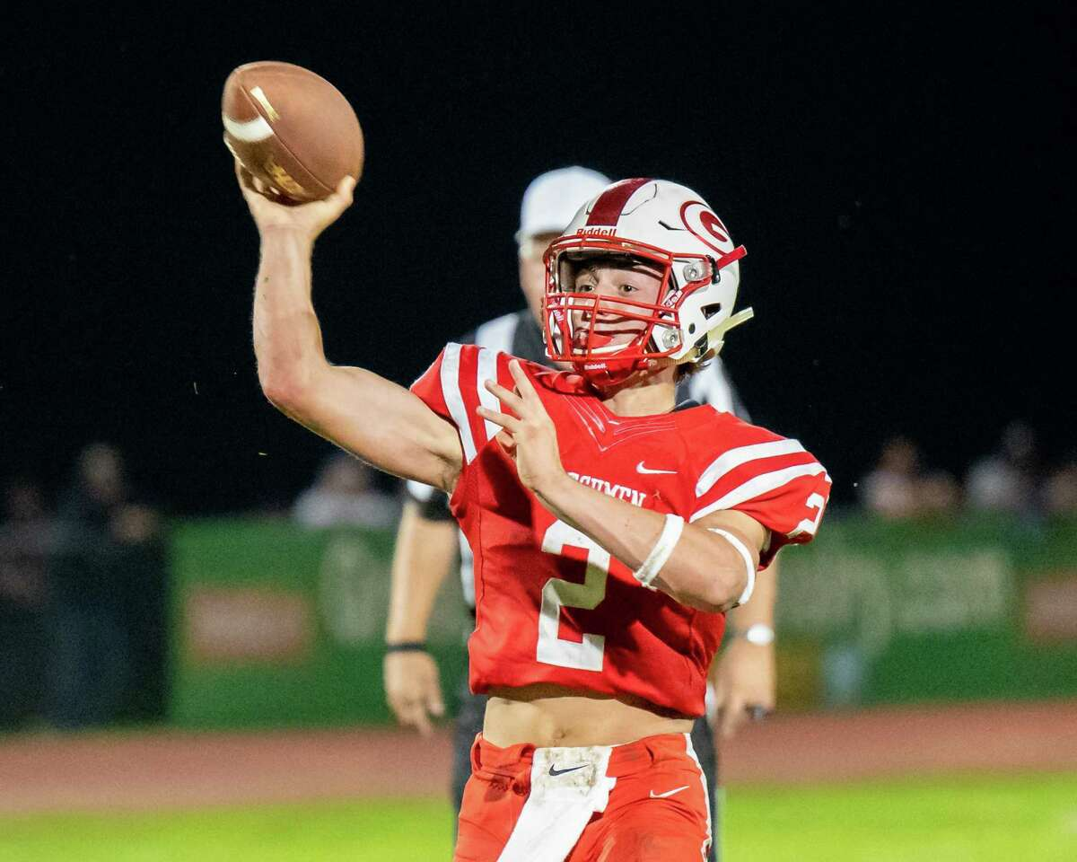 Guilderland quarterback Ty Santabarbara looks for a receiver against Shenendehowa during a Class AA matchup at Guilderland High School on Friday, Sept. 17, 2021. The Guilderland school district decided Sept. 14, 2021 that all athletes in high-risk sports ages 16 and up must be vaccinated to compete. First shots must be received by Oct. 1, 2021. (Jim Franco/Special to the Times Union)