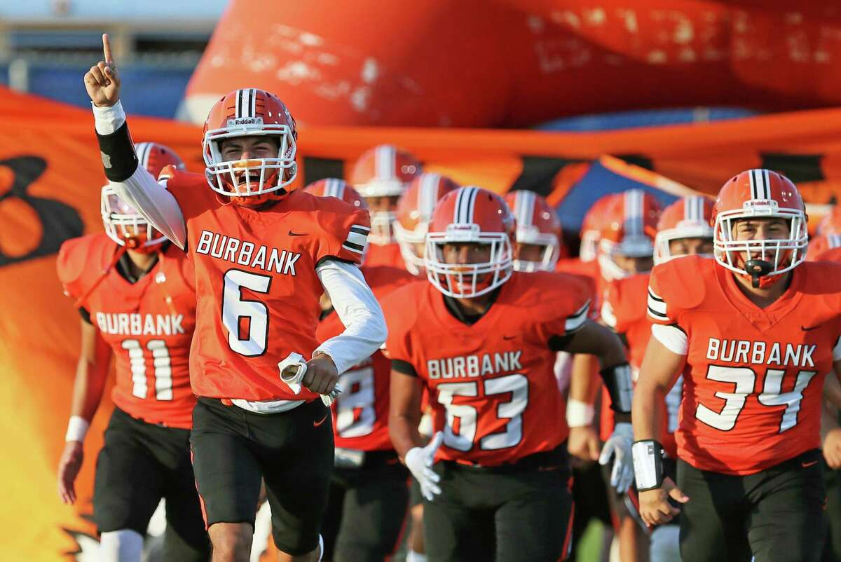 Members of the Burbank football team take to the field prior to the UIL football game against Edison Friday, Sept. 17, 2021, at SAISD Sports Complex.