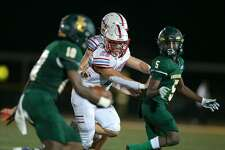 Lumberton Raider linebacker Colton Orr (23) gets ready to tackle East Chambers quarterback Jacoby Perrault (10) Friday night at Buccaneer Stadium. Photo taken September 17, 2021 Jarrod Brown for Beaumont Enterprise