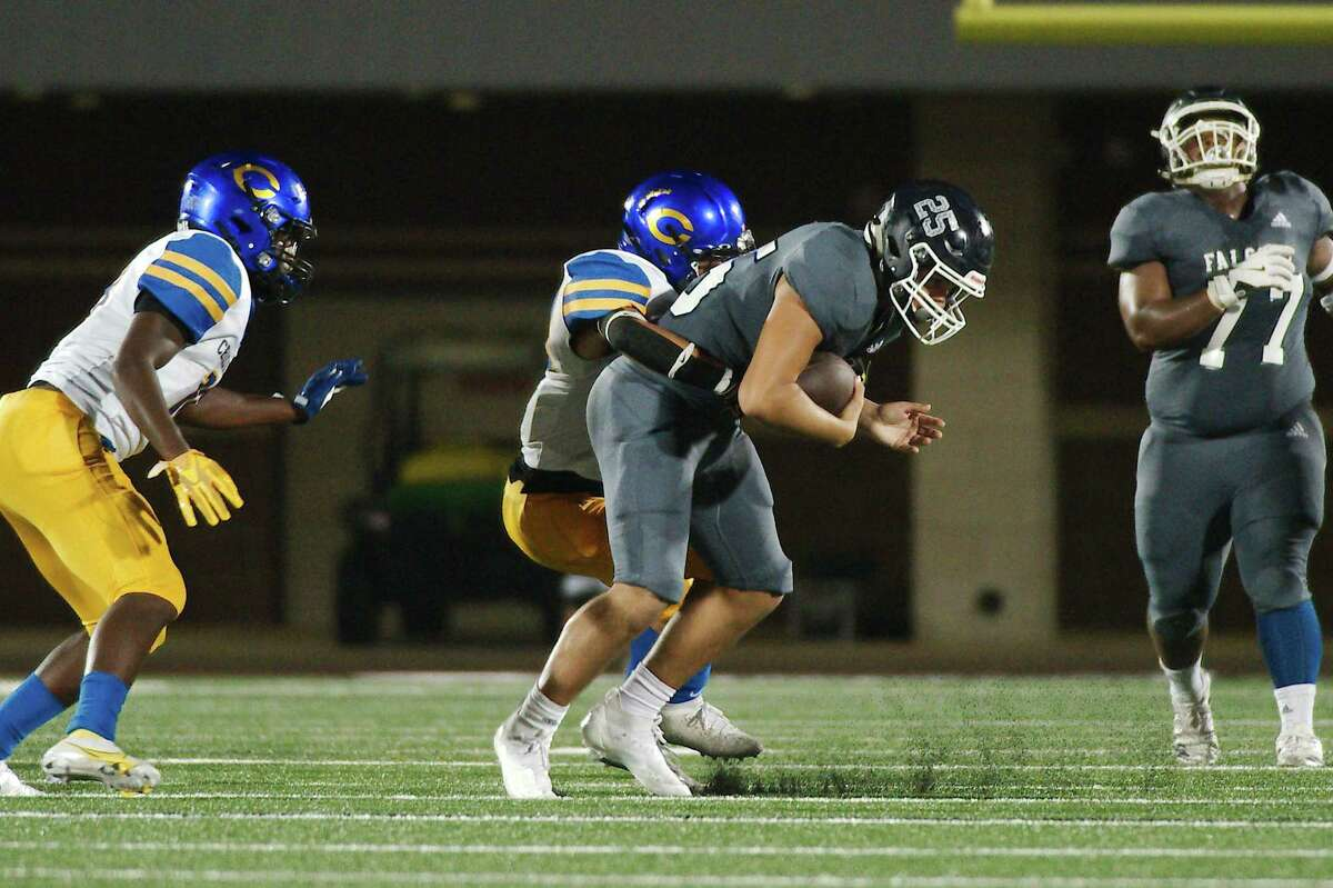 Clear Lake's Sebastian Vivero (25) fights to break the tackle of Channelview's Jimmy Guzman (28) Friday, Sep. 17, 2021 at Challenger Columbia Stadium.
