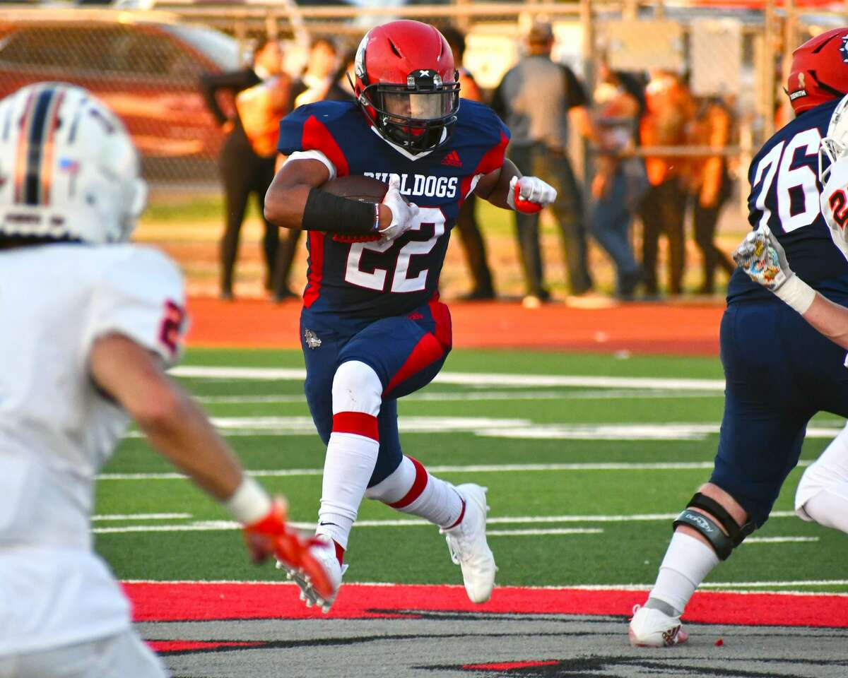 Plainview's Dorian Woods looks for a running lane during a non-district football game against Dumas on Friday in Greg Sherwood Memorial Bulldog Stadium.