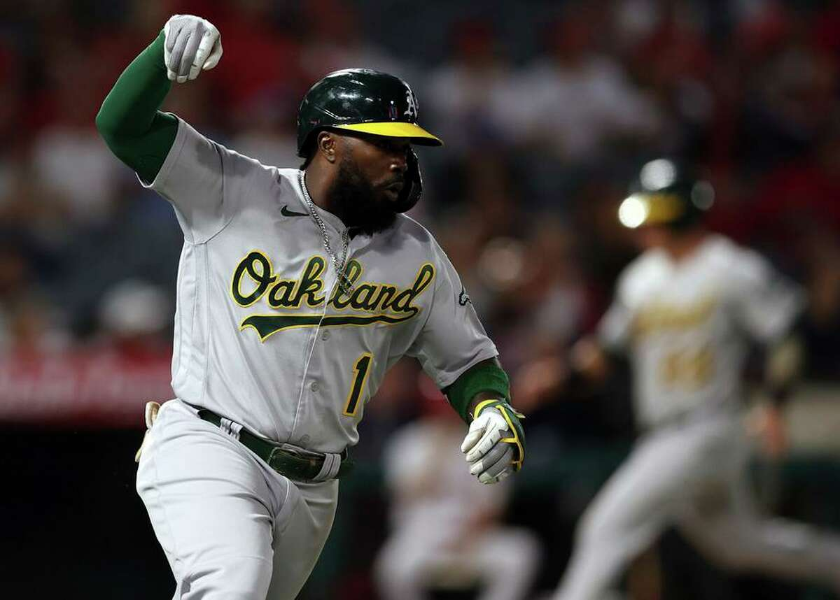 A's infielder Josh Harrison celebrates after hitting an RBI single in the second inning against the Angels in Anaheim.