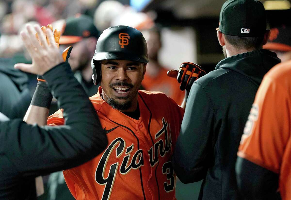SAN FRANCISCO, CALIFORNIA - SEPTEMBER 17: LaMonte Wade Jr. #31 of the San Francisco Giants is congratulated by teammates after he hit a solo home run against the Atlanta Braves in the bottom of the fourth inning at Oracle Park on September 17, 2021 in San Francisco, California. (Photo by Thearon W. Henderson/Getty Images)