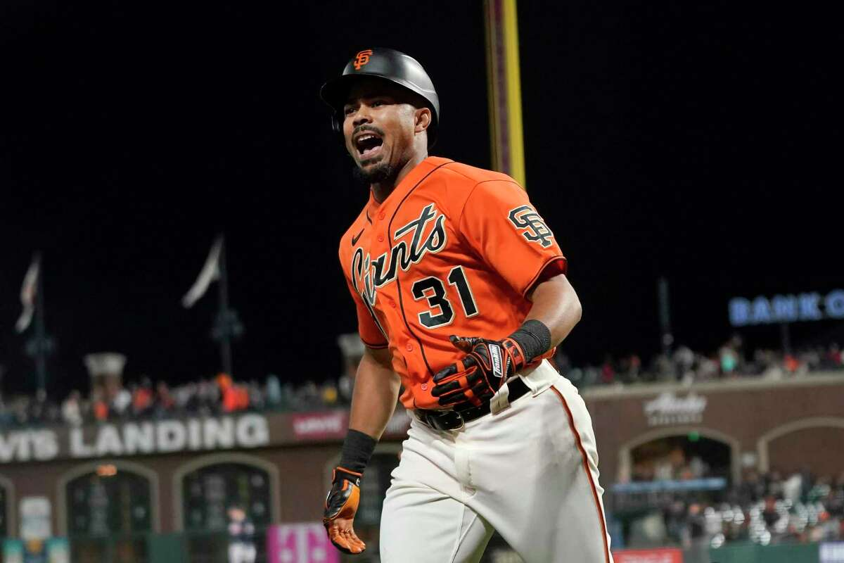 San Francisco Giants' LaMonte Wade Jr. reacts after hitting a home run against the Atlanta Braves during the fourth inning of a baseball game in San Francisco, Friday, Sept. 17, 2021. (AP Photo/Jeff Chiu)