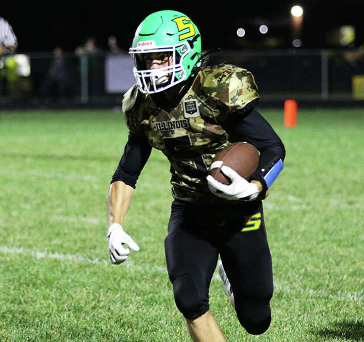 Southwestern's Gavin Day finds running room for some of his 95 rushing yards Friday night at Knapp Field in Piasa.