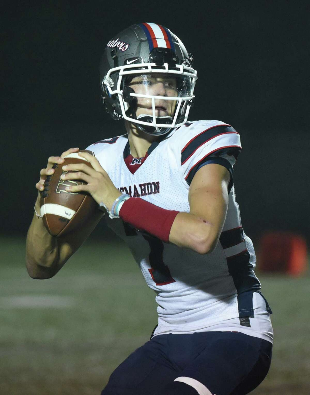 Brien McMahon quarterback Callum Letters (7) gets set to throw a pass against New Canaan during a football game at Dunning Field in New Canaan on Friday, Sept. 17, 2021.