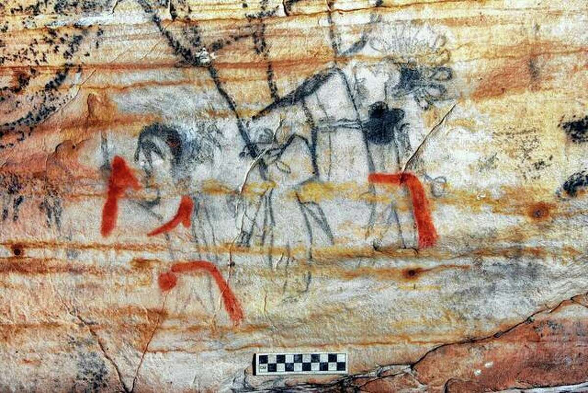 """An undated photo provided by Alan Cressler shows a Missouri cave featuring artwork from the Osage Nation dating back more than 1,000 years. The cave was sold at auction this week. The art inside """"Picture Cave"""" shows humans, animals and mythical creatures."""