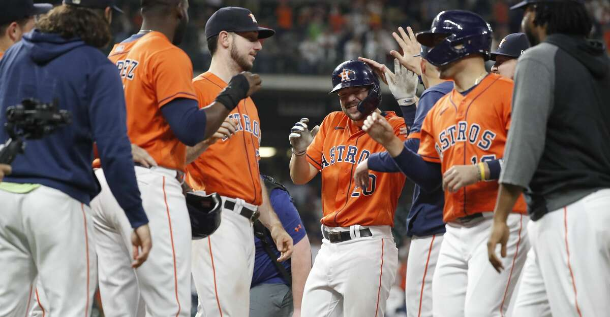 Houston Astros Chas McCormick (20) reacts with teammates after being hit by a pitch from Arizona Diamondbacks relief pitcher Tyler Clippard (36) with the bases loaded which scored the winning run during the tenth inning of an MLB baseball game at Minute Maid Park, Friday, September 17, 2021, in Houston. Astros won 4-3.