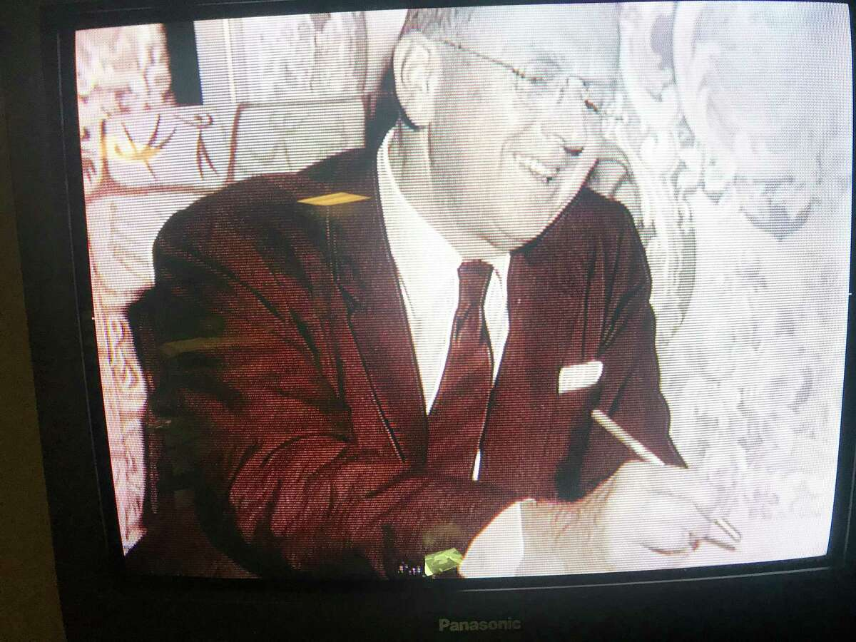 The Rev. Norman Vincent Peale relaxes in his room at the St. Anthony Hotel between sermons at Trinity Baptist Church and the Little Church of La Villita, where new bells and a organ were dedicated to him on Sept 15, 1957.