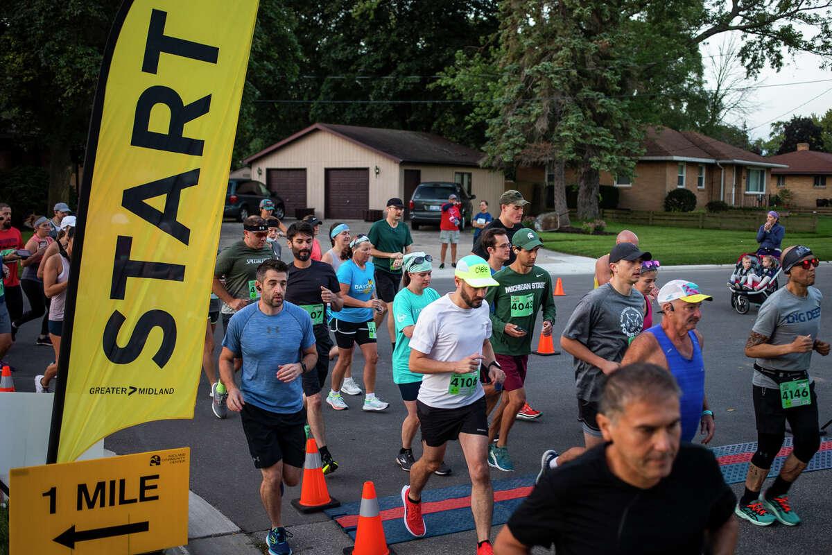 Runners and walkers start their half marathon race during the 2021 Dow RunWalk Saturday, Sept. 18, 2021 at the Greater Midland Community Center. (Katy Kildee/kkildee@mdn.net)