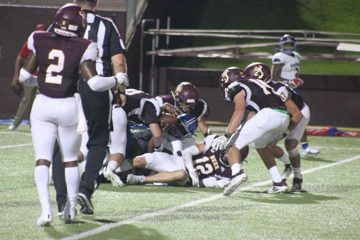 Deer Park's defense stops Bruin quarterback Jayden Briscoe at the goal line for their second crucial stop at the doorstep to the end zone Friday night.