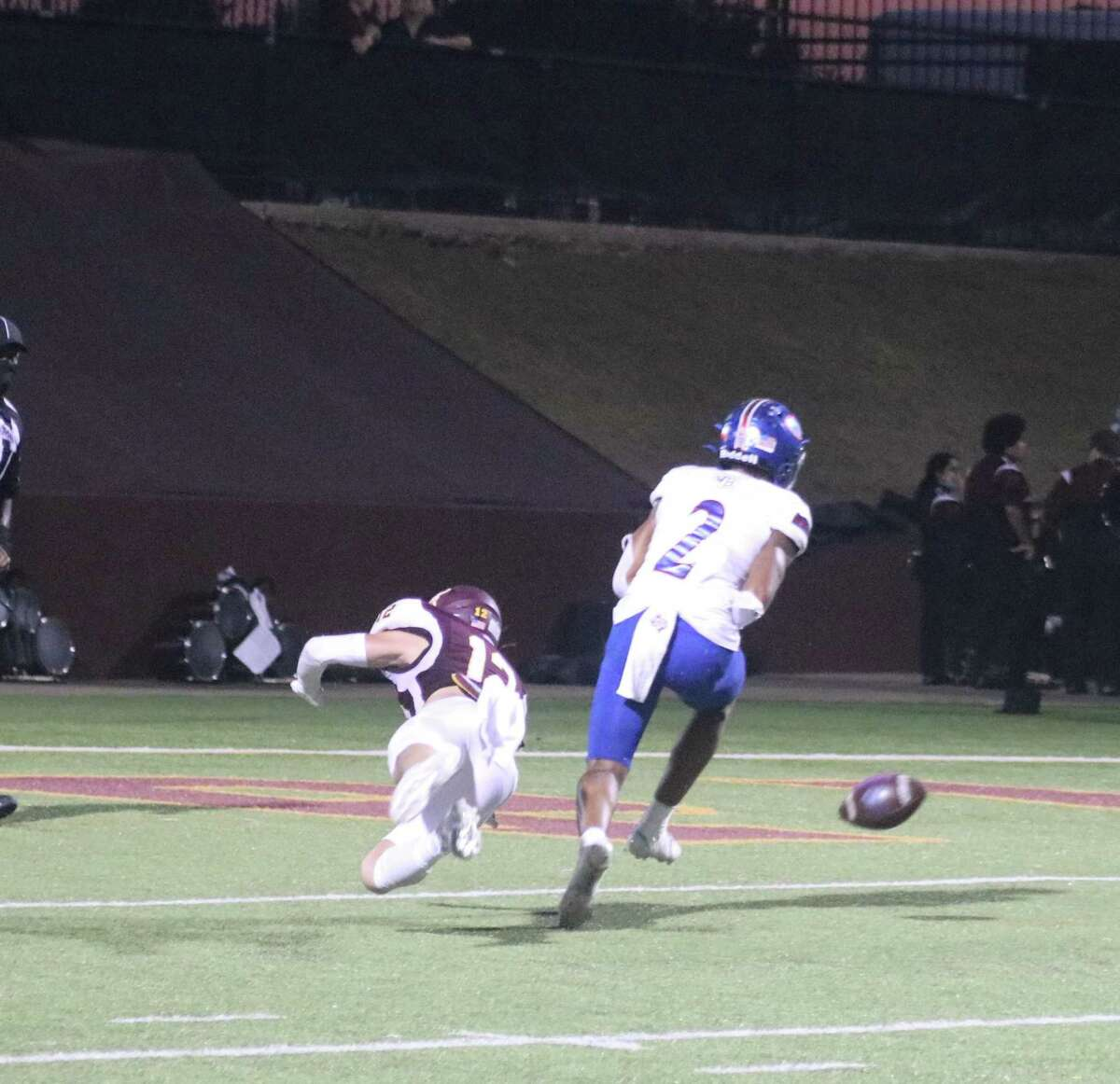 Deer Park's Jake Schaper finishes breaking up a deep pass to Beaumont West Brook's Andre Dennis near the end zone Friday night. Dennis became the hero for the Bruins in the second half when he caught a short pass and turned it into a 99-yard sprint to the end zone.