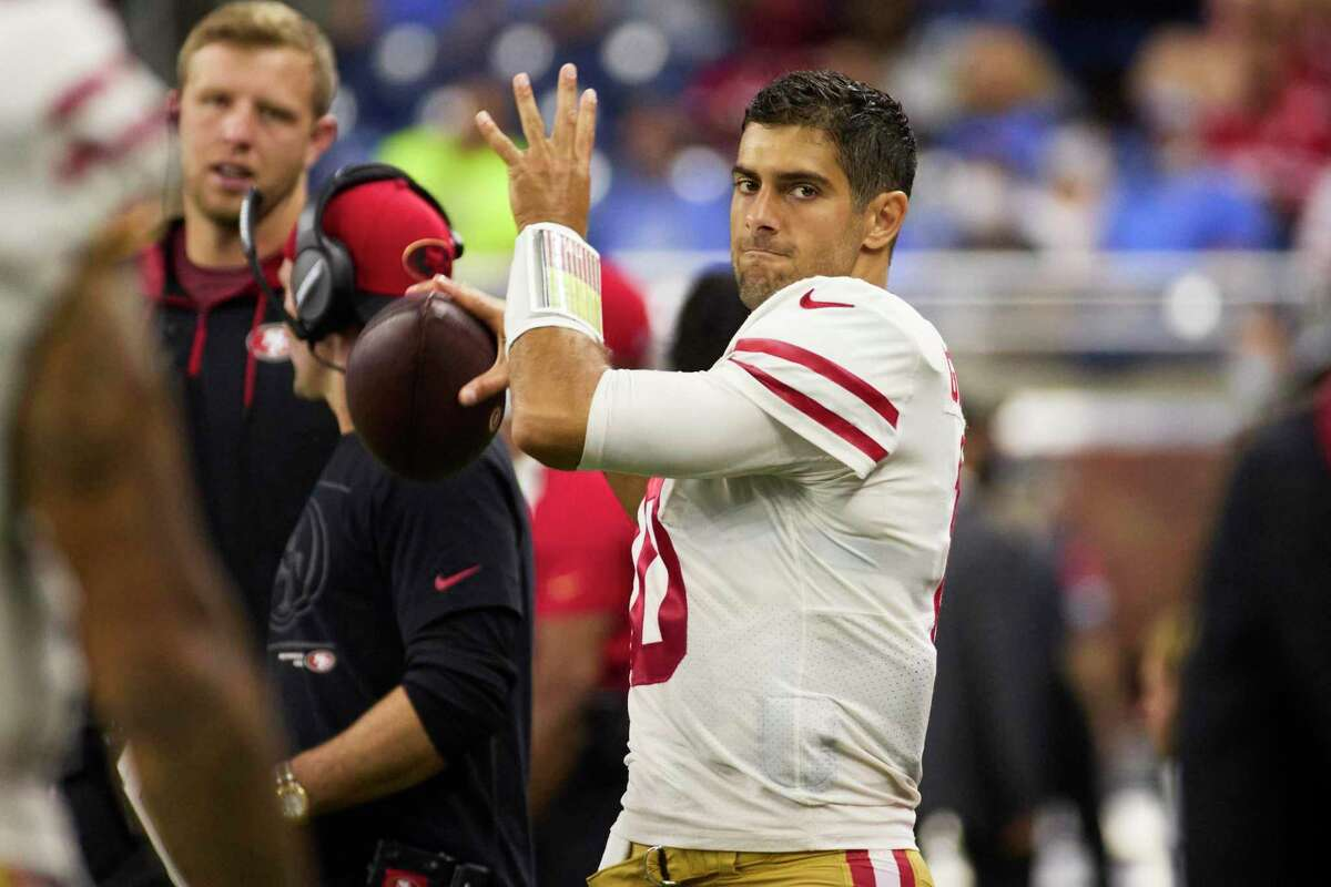 San Francisco 49ers quarterback Jimmy Garoppolo (10) warms up on the sideline against the Detroit Lions during an NFL football game, Sunday, Sept. 12, 2021, in Detroit. (AP Photo/Rick Osentoski)