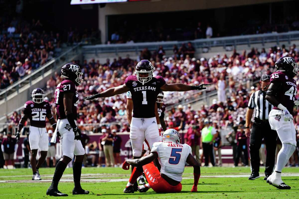 COLLEGE STATION, TX - SEPTEMBER 18: Linebacker Aaron Hansford #1 of the Texas A&M Aggies celebrates a stop during the first quarter of the game against New Mexico Lobos at Kyle Field on September 18, 2021 in College Station, Texas.