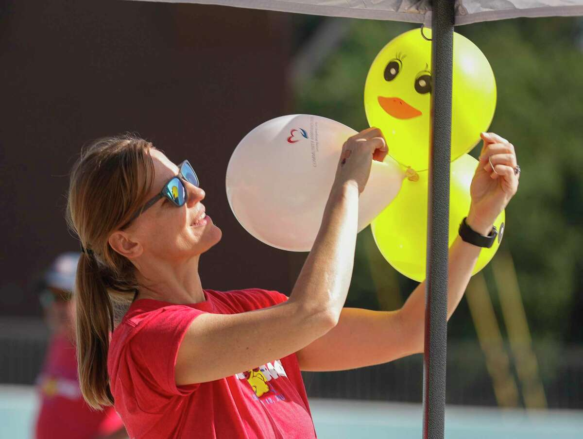 Volunteer Monica Bomkamp Enia decorates with duck-themed balloons with the Community Assistance Center take part in the organization's duck race at Big Rivers Waterpark, Saturday, Sept. 18, 2021, in New Caney. The annual event raises money for the non-profit that provides resources and needs to struggling individuals and families in Montgomery County.