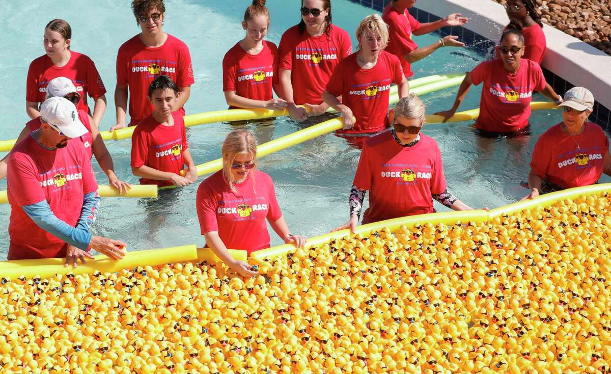 Volunteers from the Community Assistance Center participate in the organization's duck race at Big Rivers Water Park on Saturday, September 18, 2021, in New Caney.  The annual event raises funds for the nonprofit organization that provides resources and needs to struggling individuals and families in Montgomery County.